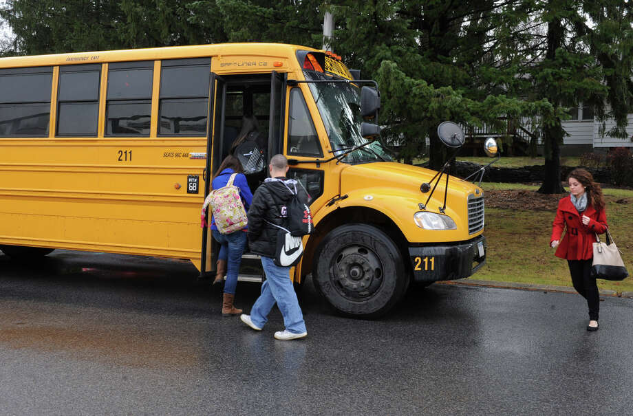 A school bus in the Times Union parking lot picks up New Vision students on Tuesday Dec. 18, 2012 in Colonie, N.Y. (Lori Van Buren / Times Union) Photo: Lori Van Buren