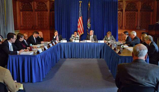 Secretary to the Governor Larry Schwartz, center, chairs the Mandate Relief Council meeting at the Capitol Tuesday Dec. 18, 2012. (John Carl D'Annibale / Times Union) Photo: John Carl D'Annibale