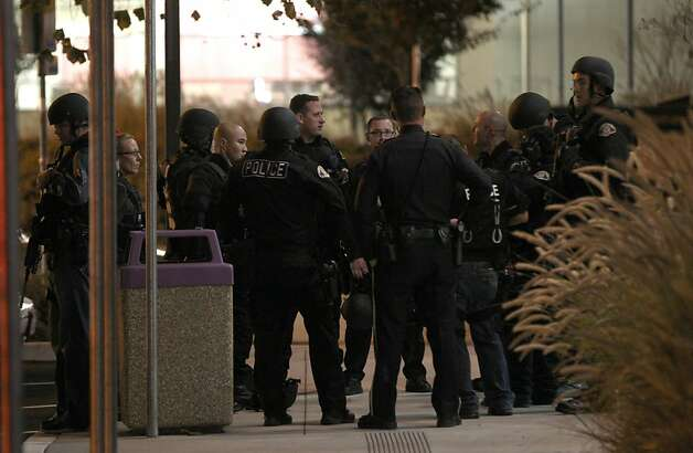 San Jose Police are debriefed after they searched the Technology Center Building on the San Jose City College campus Tuesday, Dec. 18, 2012 in San Jose, California. Reports of a man carrying a rifle were called into police from the parents of a student who said he witnessed the incident. Photo: Lance Iversen, The Chronicle