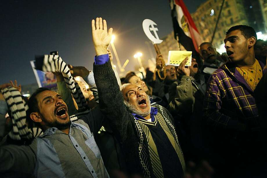 Raise your hand if you're surePresident Mohammed Morsi's new Islamist-backed draft constitution, which is being put to a referendum, poses a grave threat to democracy in Egypt. These protesters in Cairo's Tahrir Square are. Photo: Mahmoud Khaled, AFP/Getty Images