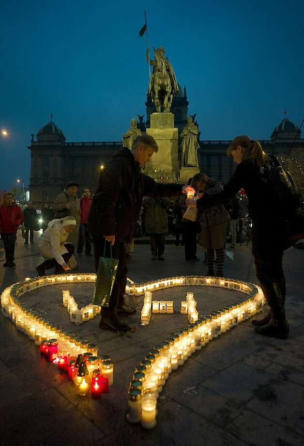 People light candles for former president Vaclav Havel during the commemorating of the first anniversary of his death at Wenceslas square in Prague on December 18, 2012. Havel, a dissident and playwright who was the hero of the 1989 Velvet Revolution against communist rule and became his country's first post-independence president, died on December 18, 2011 aged 75. Photo: Michal Cizek, AFP/Getty Images