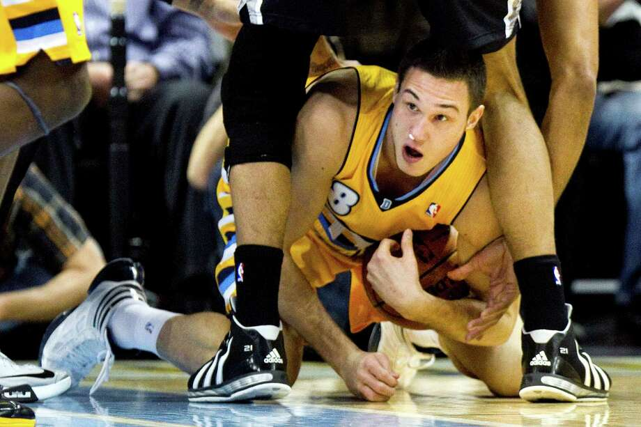 Danilo Gallinari led the Nuggets with 28 points and also hustled his way to a loose ball between the legs of the Spurs' Tim Duncan. Photo: Barry Gutierrez, FRE / FR170088 AP