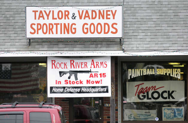 A sign advertising the sale of Rock River Arms AR 15 rifles and Team Glock outside of Taylor & Vadney Sporting Goods Store on Tuesday Dec. 18, 2012 in Rotterdam, N.Y. (Lori Van Buren / Times Union) Photo: Lori Van Buren