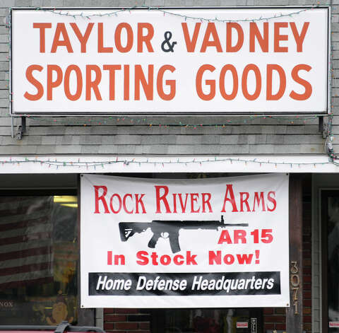 A sign advertising the sale of Rock River Arms AR 15 rifles outside of Taylor & Vadney Sporting Goods Store on Tuesday Dec. 18, 2012 in Rotterdam, N.Y. (Lori Van Buren / Times Union) Photo: Lori Van Buren
