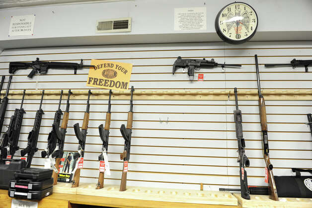 A partly empty rifle display in Taylor & Vadney Sporting Goods Store on Tuesday Dec. 18, 2012 in Rotterdam, N.Y. (Lori Van Buren / Times Union) Photo: Lori Van Buren