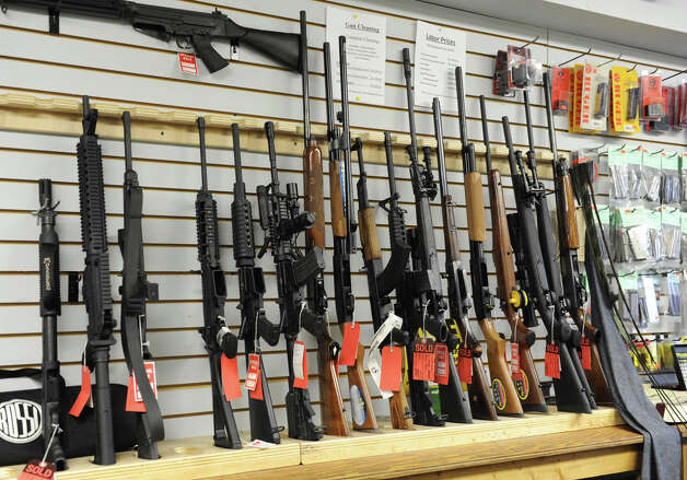A display of rifles in Taylor & Vadney Sporting Goods Store on Tuesday Dec. 18, 2012 in Rotterdam, N.Y. (Lori Van Buren / Times Union) Photo: Lori Van Buren