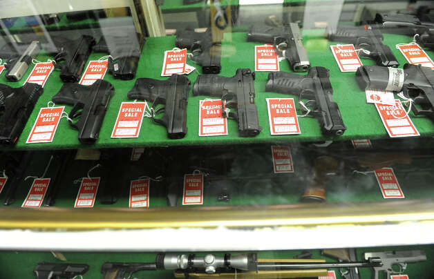 A display of pistols in Taylor & Vadney Sporting Goods Store on Tuesday Dec. 18, 2012 in Rotterdam, N.Y. (Lori Van Buren / Times Union) Photo: Lori Van Buren