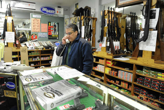 Pat Popolizio, owner of Taylor & Vadney Sporting Goods Store, is busy answering phone calls in his gun shop on Tuesday Dec. 18, 2012 in Rotterdam, N.Y. (Lori Van Buren / Times Union) Photo: Lori Van Buren
