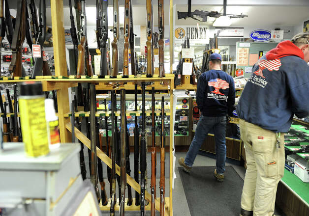 Customers look at guns in Taylor & Vadney Sporting Goods Store on Tuesday Dec. 18, 2012 in Rotterdam, N.Y. (Lori Van Buren / Times Union) Photo: Lori Van Buren