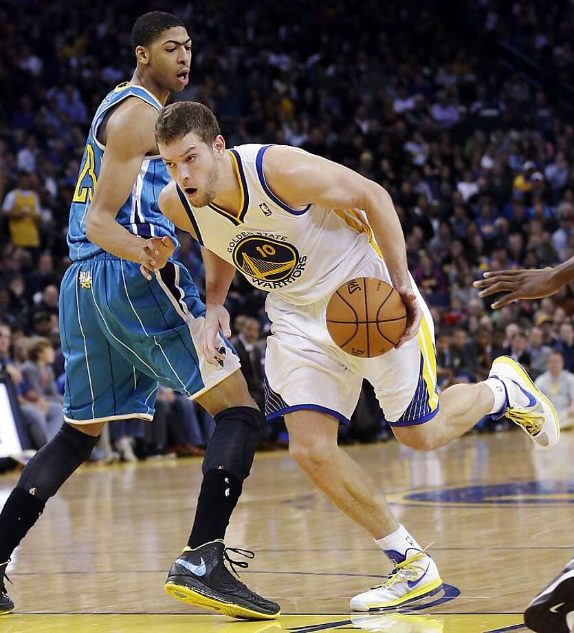 Golden State Warriors' David Lee (10) dribbles past New Orleans Hornets' Anthony Davis (23) during the first half of an NBA basketball game in Oakland, Calif., Tuesday, Dec. 18, 2012. (AP Photo/Marcio Jose Sanchez) Photo: Marcio Jose Sanchez, Associated Press