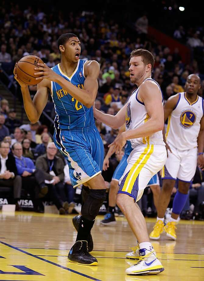 OAKLAND, CA - DECEMBER 18: Anthony Davis #23 of the New Orleans Hornets looks to pass around David Lee #10 of the Golden State Warriors at Oracle Arena on December 18, 2012 in Oakland, California. NOTE TO USER: User expressly acknowledges and agrees that, by downloading and or using this photograph, User is consenting to the terms and conditions of the Getty Images License Agreement.  (Photo by Ezra Shaw/Getty Images) Photo: Ezra Shaw, Getty Images