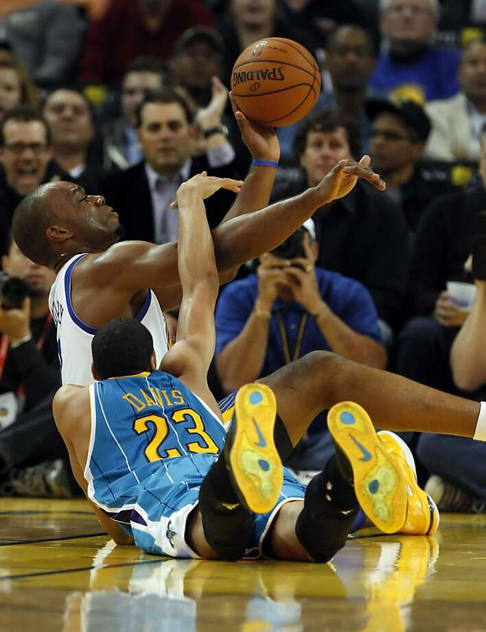 Carl Landry, rear, and Anthony Davis, front, fight for a loose ball in the fourth quarter. The Golden State Warriors played the New Orleans Hornets at OracleArena in Oakland, Calif., on Tuesday, December 18, 2012, defeating the Hornets 103-96 Photo: Carlos Avila Gonzalez, The Chronicle
