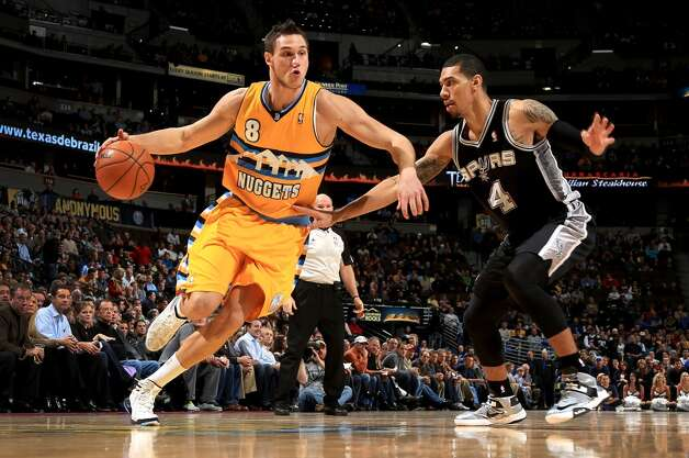 Danilo Gallinari #8 of the Denver Nuggets controls the ball against Danny Green #4 of the San Antonio Spurs at the Pepsi Center on December 18, 2012 in Denver, Colorado. (Doug Pensinger / Getty Images)