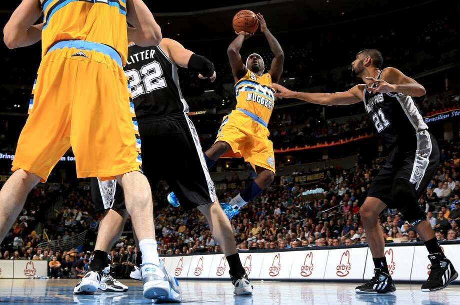 Ty Lawson #3 of the Denver Nuggets takes a shot against Tim Duncan #21 of the San Antonio Spurs at the Pepsi Center on December 18, 2012 in Denver, Colorado. (Doug Pensinger / Getty Images)