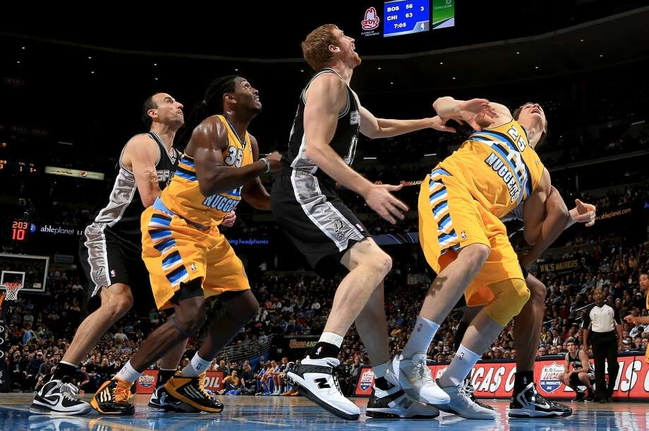 Manu Ginobili #20 (L-R) of the San Antonio Spurs, Kenneth Faried #35 of the Denver Nuggets, Matt Bonner #15 of the San Antonio Spurs and Timofey Mozgov #25 of the Denver Nuggets battle for rebounding position at the Pepsi Center on December 18, 2012 in Denver, Colorado. (Doug Pensinger / Getty Images)