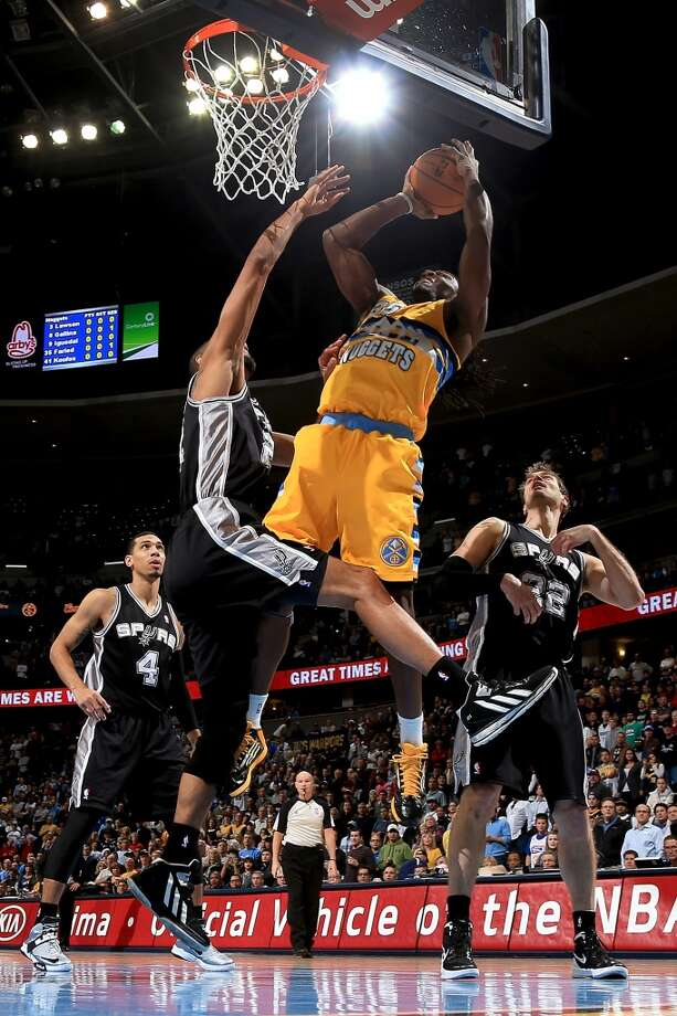 Kenneth Faried #35 of the Denver Nuggets takes a shot against Tim Duncan #21 of the San Antonio Spurs at the Pepsi Center on December 18, 2012 in Denver, Colorado. (Doug Pensinger / Getty Images)