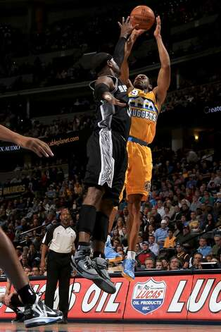 Andre Iguodala #9 of the Denver Nuggets takes a shot against Stephen Jackson #3 of the San Antonio Spurs at the Pepsi Center on December 18, 2012 in Denver, Colorado. (Doug Pensinger / Getty Images)