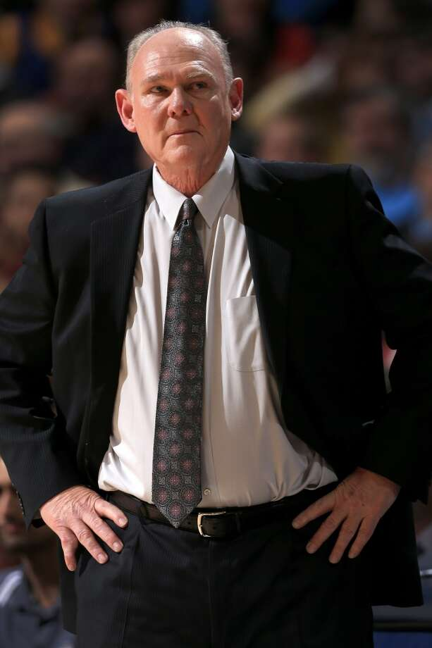 Head coach George Karl of the Denver Nuggets leads his team against the San Antonio Spurs at the Pepsi Center on December 18, 2012 in Denver, Colorado. (Doug Pensinger / Getty Images)