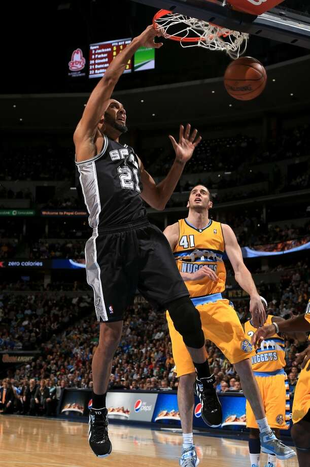 Tim Duncan #21 of the San Antonio Spurs dunks the ball against Kosta Koufos #41 of the Denver Nuggetsat the Pepsi Center on December 18, 2012 in Denver, Colorado. The Nuggets defeated the Spurs 112-106. (Doug Pensinger / Getty Images)