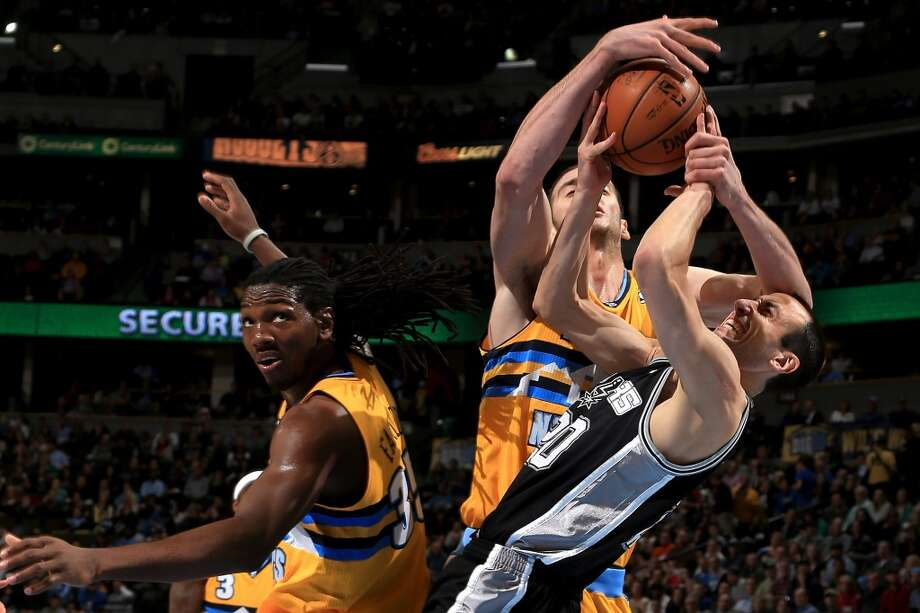 Manu Ginobili #20 of the San Antonio Spurs is fouled by Kosta Koufos #41 of the Denver Nuggets as Kenneth Faried #35 of the Denver Nuggets avoids the play at the Pepsi Center on December 18, 2012 in Denver, Colorado. The Nuggets defeated the Spurs 112-106. (Doug Pensinger / Getty Images)