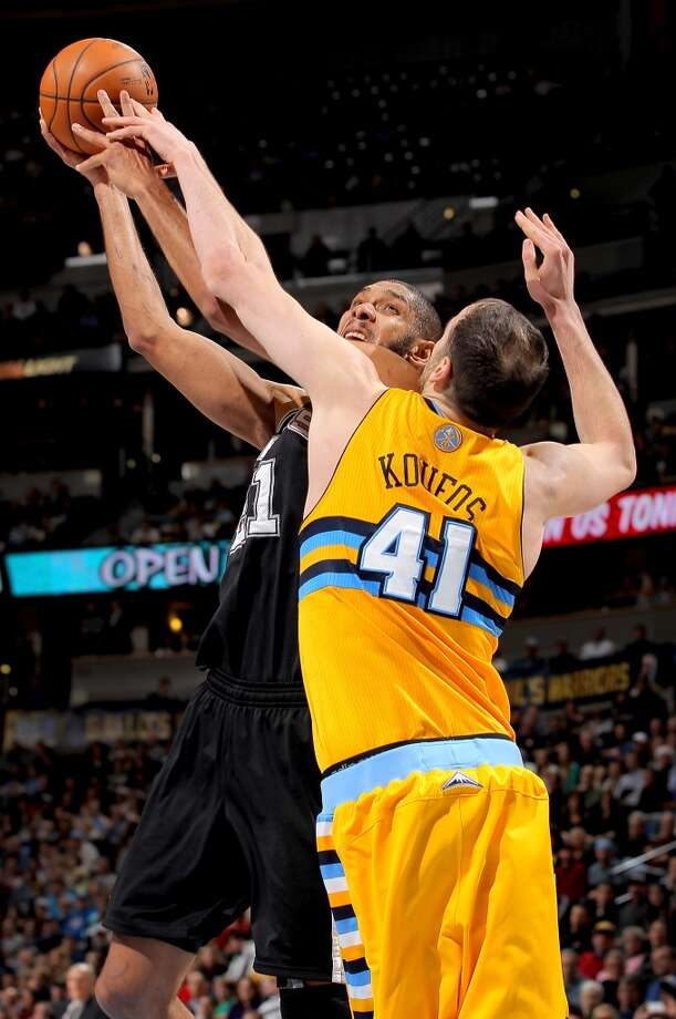 Tim Duncan #21 of the San Antonio Spurs has his shot contested by Kosta Koufos #41 of the Denver Nuggets at the Pepsi Center on December 18, 2012 in Denver, Colorado. The Nuggets defeated the Spurs 112-106. (Doug Pensinger / Getty Images)