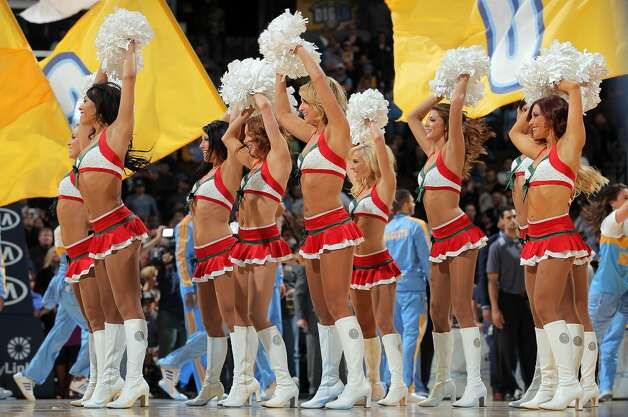 The Denver Nuggets dance team performs during a break in the action against the San Antonio Spurs at the Pepsi Center on December 18, 2012 in Denver, Colorado. The Nuggets defeated the Spurs 112-106. (Doug Pensinger / Getty Images)