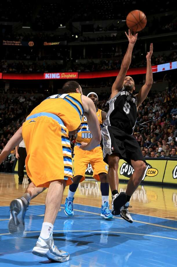 Tony Parker #9 of the San Antonio Spurs takes a shot over Kosta Koufos #41 of the Denver Nuggets at the Pepsi Center on December 18, 2012 in Denver, Colorado. The Nuggets defeated the Spurs 112-106. (Doug Pensinger / Getty Images)
