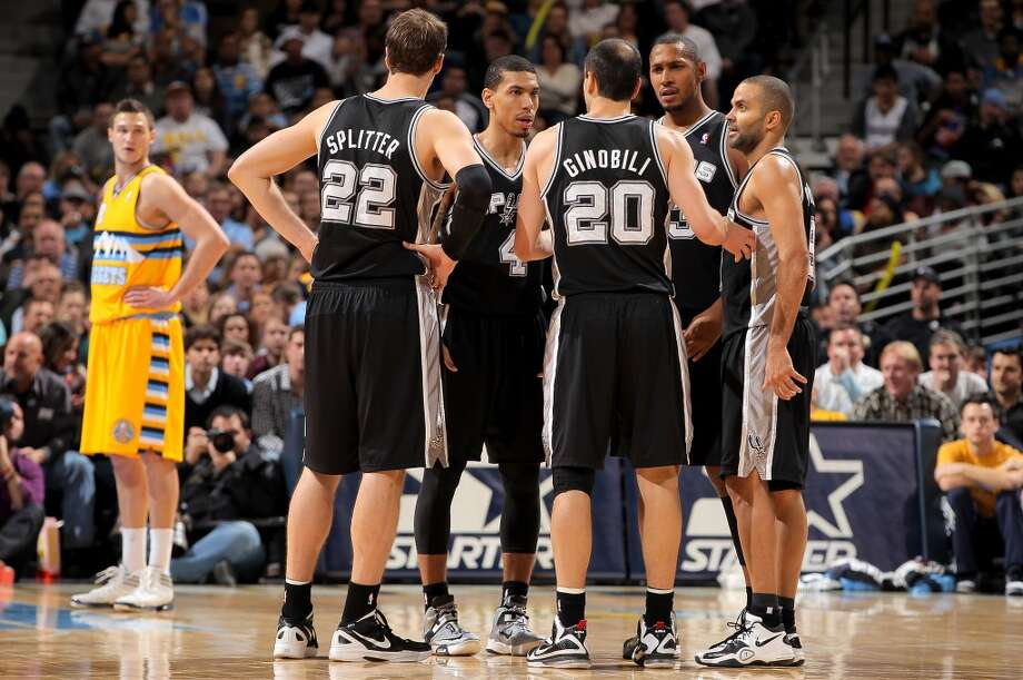 Tiago Splitter #22, Danny Green #4, Manu Ginobili #20, Boris Diaw #33 and Tony Parker #9 of the San Antonio Spurs huddle up during a break in the action as Danilo Gallinari #8 (L) of the Denver Nuggets looks on at the Pepsi Center on December 18, 2012 in Denver, Colorado. The Nuggets defeated the Spurs 112-106. (Doug Pensinger / Getty Images)
