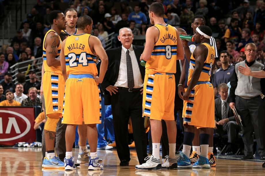 Head coach George Karl (C) of the Denver Nuggets huddles his team during a break in the action against the San Antonio Spurs at the Pepsi Center on December 18, 2012 in Denver, Colorado. The Nuggets defeated the Spurs 112-106. (Doug Pensinger / Getty Images)
