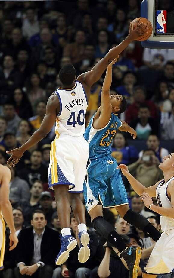 Harrison Barnes fights for a rebound against Anthony Davis of the Hornets in the fourth quarter. The Golden State Warriors played the New Orleans Hornets at OracleArena in Oakland, Calif., on Tuesday, December 18, 2012, defeating the Hornets 103-96 Photo: Carlos Avila Gonzalez, The Chronicle