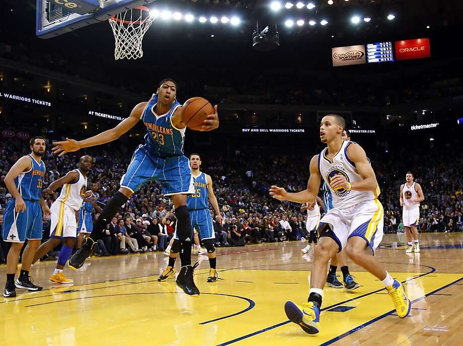 Anthony Davis of the Hornets gets a rebound in the second half. The Golden State Warriors played the New Orleans Hornets at OracleArena in Oakland, Calif., on Tuesday, December 18, 2012, defeating the Hornets 103-96 Photo: Carlos Avila Gonzalez, The Chronicle