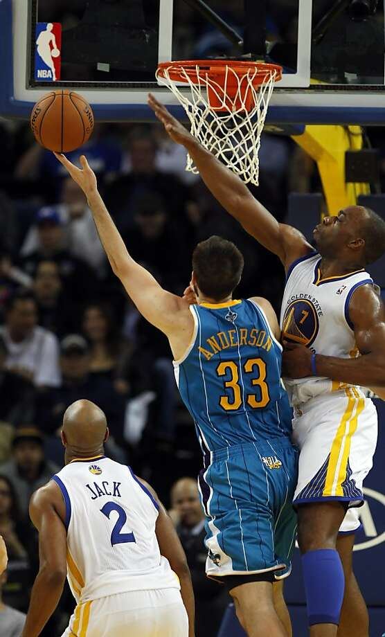 Carl Landry defends against Ryan Anderson in the fourth quarter. The Golden State Warriors played the New Orleans Hornets at OracleArena in Oakland, Calif., on Tuesday, December 18, 2012, defeating the Hornets 103-96 Photo: Carlos Avila Gonzalez, The Chronicle