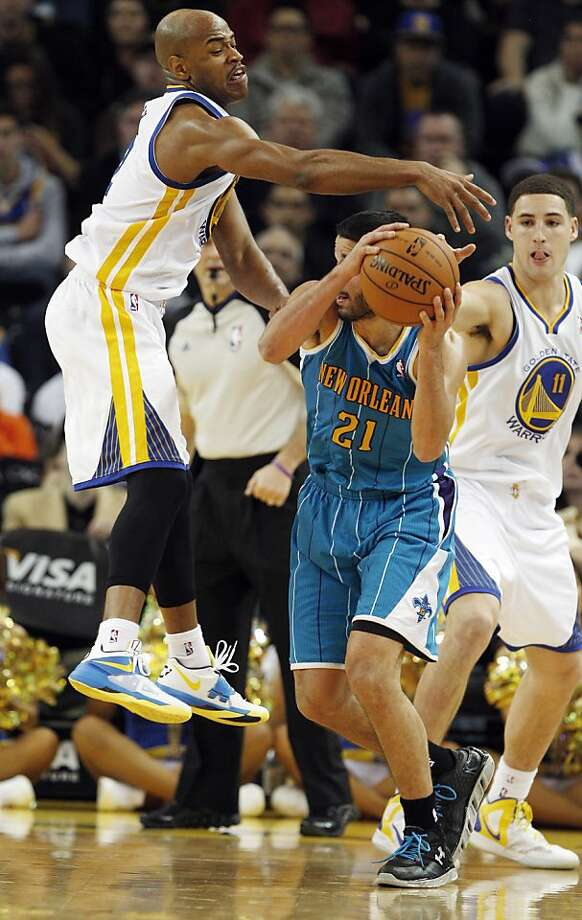 Jarrett Jack defends against Hornets' Greivis Vasquez in the fourth quarter. The Golden State Warriors played the New Orleans Hornets at OracleArena in Oakland, Calif., on Tuesday, December 18, 2012, defeating the Hornets 103-96 Photo: Carlos Avila Gonzalez, The Chronicle