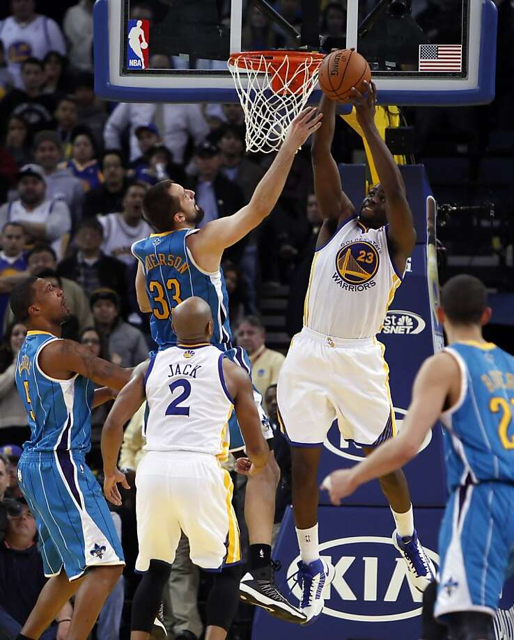 Draymond Green pulls in a rebound in the fourth quarter. The Golden State Warriors played the New Orleans Hornets at OracleArena in Oakland, Calif., on Tuesday, December 18, 2012, defeating the Hornets 103-96 Photo: Carlos Avila Gonzalez, The Chronicle