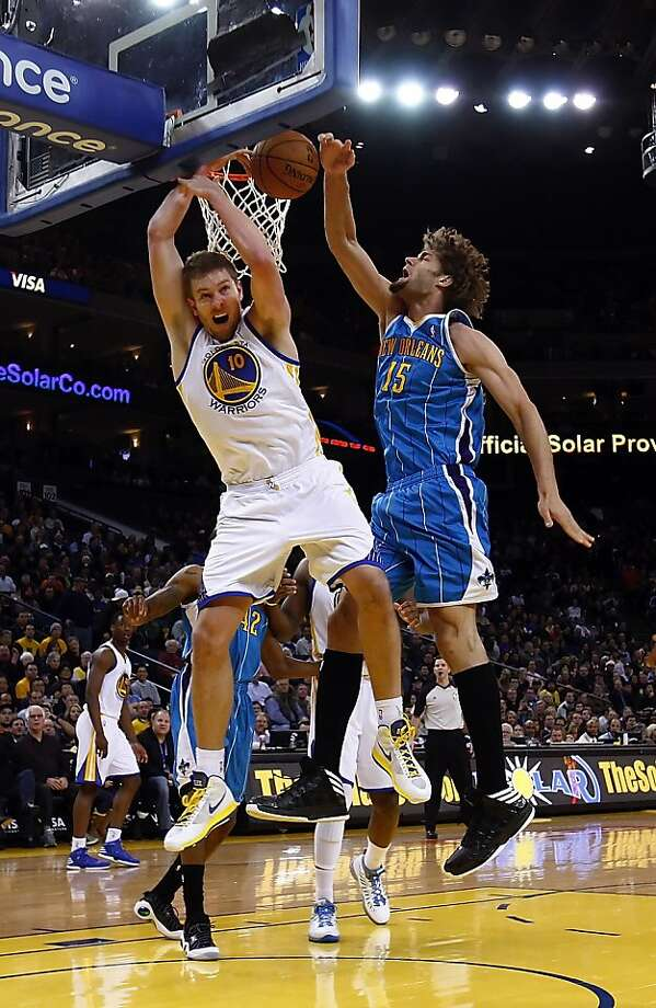 David Lee is fouled by Robin Lopez of the Hornets in the first half. The Golden State Warriors played the New Orleans Hornets at OracleArena in Oakland, Calif., on Tuesday, December 18, 2012, defeating the Hornets 103-96 Photo: Carlos Avila Gonzalez, The Chronicle