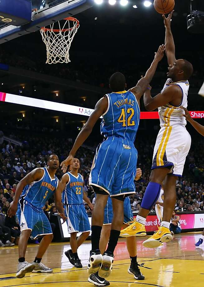 Carl Landry puts up a shot in the first half against the Hornets. The Golden State Warriors played the New Orleans Hornets at OracleArena in Oakland, Calif., on Tuesday, December 18, 2012, defeating the Hornets 103-96 Photo: Carlos Avila Gonzalez, The Chronicle
