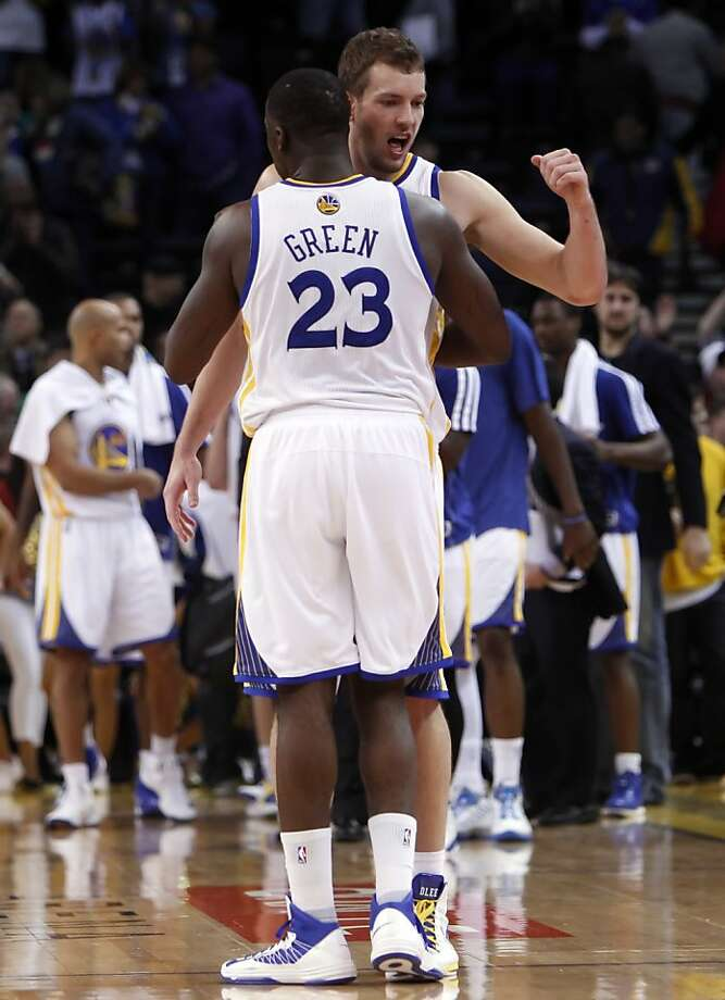 David Lee and Draymond Green celebrate their victory against the Hornets. The Golden State Warriors played the New Orleans Hornets at OracleArena in Oakland, Calif., on Tuesday, December 18, 2012, defeating the Hornets 103-96 Photo: Carlos Avila Gonzalez, The Chronicle
