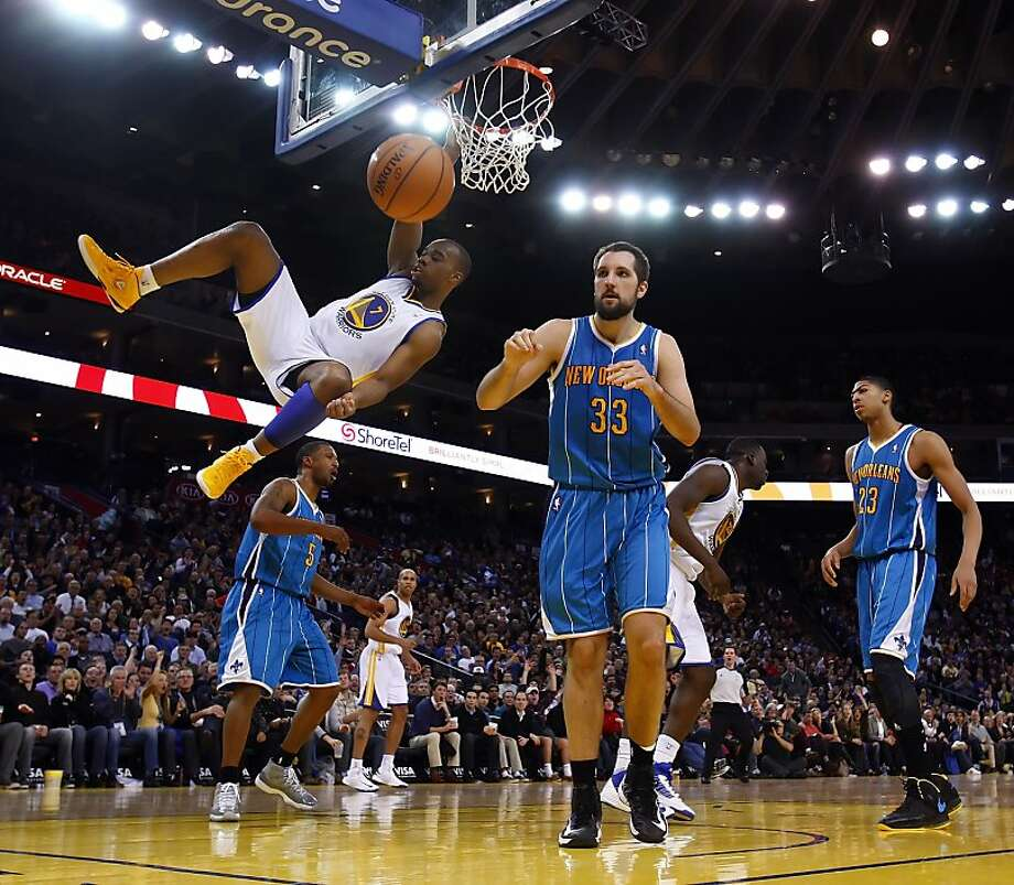 Carl Landry hangs from the rim after dunking the ball in the second half. The Golden State Warriors played the New Orleans Hornets at OracleArena in Oakland, Calif., on Tuesday, December 18, 2012, defeating the Hornets 103-96 Photo: Carlos Avila Gonzalez, The Chronicle
