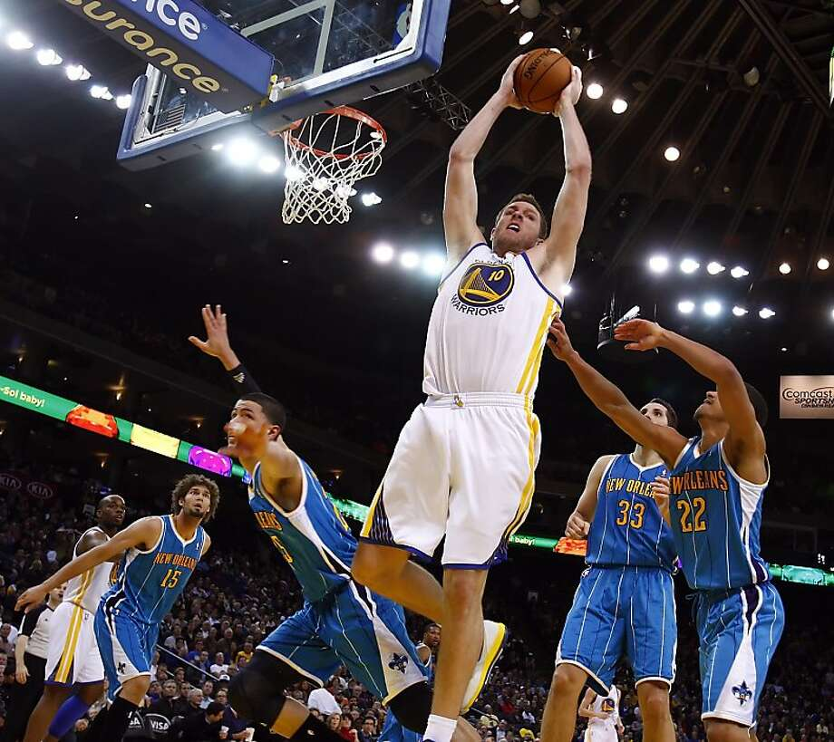 David Lee pulls in a rebound in the fourth quarter. The Golden State Warriors played the New Orleans Hornets at OracleArena in Oakland, Calif., on Tuesday, December 18, 2012, defeating the Hornets 103-96 Photo: Carlos Avila Gonzalez, The Chronicle