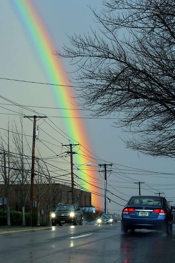 After a brief rain shower a rainbow appears by the intersection of Old Hook Rd and Tillman Street in Westwood, N.J., Tuesday Dec. 18, 2012. Photo: Kevin R. Wexler, Associated Press