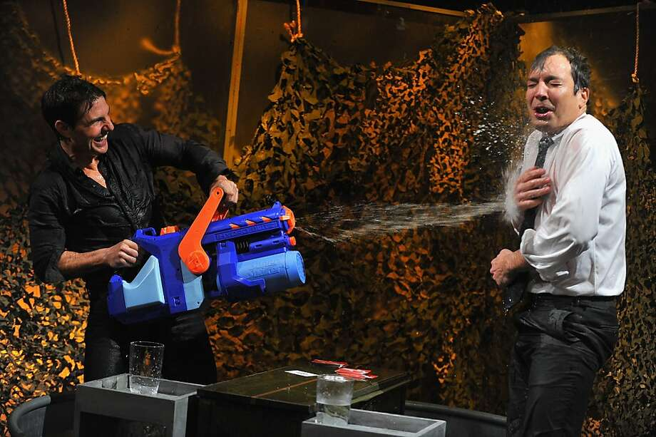 "Tom Cruise and Jimmy Fallon play a game of ""Water War"" during a taping of ""Late Night With Jimmy Fallon"">> at Rockefeller Center on December 18, 2012 in New York City. Photo: Theo Wargo, Getty Images"