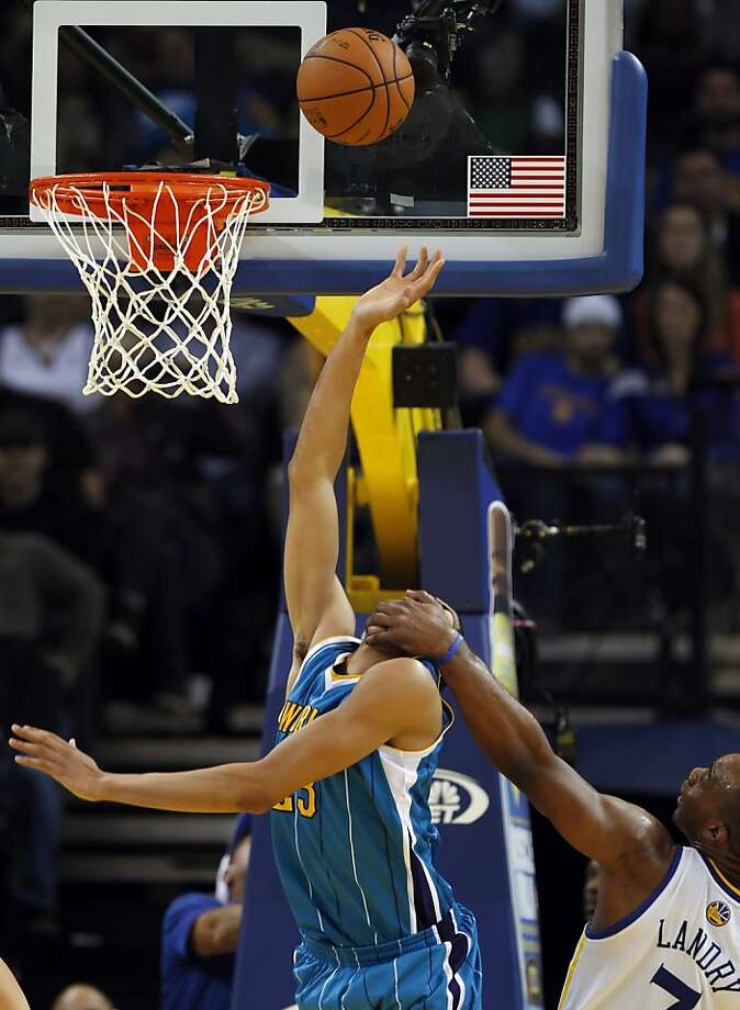 Carl Landry fouls Anthony Davis in the fourth quarter. The Golden State Warriors played the New Orleans Hornets at OracleArena in Oakland, Calif., on Tuesday, December 18, 2012, defeating the Hornets 103-96 Photo: Carlos Avila Gonzalez, The Chronicle
