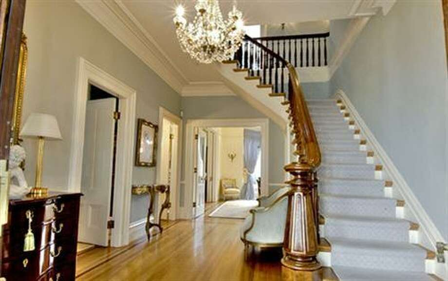 Glimpse of the foyer and staircase (redfin.com)