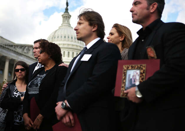 WASHINGTON, DC - DECEMBER 18:  (L-R) Survivors and family members of victims of gun violence, Jessica Watts of Aurora, Colorado, who lost her cousin Jonathan Blunk in the movie theater shooting, Colin Goddard, who was shot multiple times at the Virginia Tech shooting, local resident Nardyne Jefferies, who lost her daughter in a drive-by shooting by an AK-47-style assault rifle, Andrei Nikitchyuk of Newtown, Connecticut, whose son was in the building when the Sandy Hook Elementary School shooting happened, and Paul Wilson (R) of Seal Beach, California, who lost his wife Christy in a shooting at a hair salon, listen during a news conference at the House Triangle on Capitol Hill December 18, 2012 in Washington, DC. U.S. Rep. David Cicilline (D-RI) held a news conference with the Brady Campaign to discuss gun violence. Photo: Alex Wong, Getty Images / 2012 Getty Images