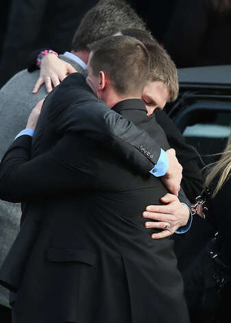 NEWTOWN, CT - DECEMBER 18:  Family and friends embrace after the funeral for shooting victim Jessica Rekos, 6, at the St. Rose of Lima Catholic church on December 18, 2012 in Newtown, Connecticut. Funeral services were held at the church for both Jessica Rekos and James Mattioli, 6, Tuesday, four days after 20 children and six adults were killed at Sandy Hook Elementary School. Photo: John Moore, Getty Images / 2012 Getty Images
