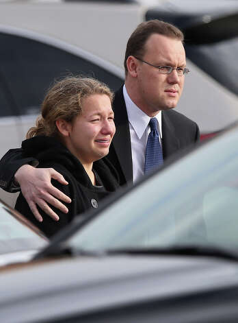 NEWTOWN, CT - DECEMBER 18:  Family and friends depart the funeral for shooting victim Jessica Rekos, 6, at the St. Rose of Lima Catholic church on December 18, 2012 in Newtown, Connecticut. Funeral services were held at the church for both Jessica Rekos and James Mattioli, 6, Tuesday, four days after 20 children and six adults were killed at Sandy Hook Elementary School. Photo: John Moore, Getty Images / 2012 Getty Images