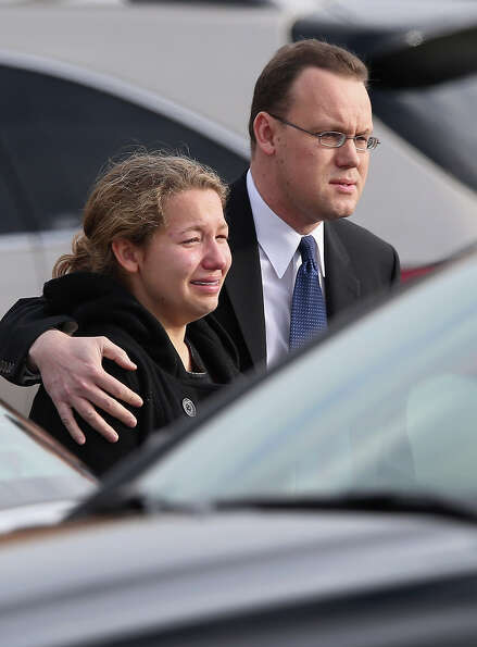 NEWTOWN, CT - DECEMBER 18:  Family and friends depart the funeral for shooting victim Jessica Rekos,