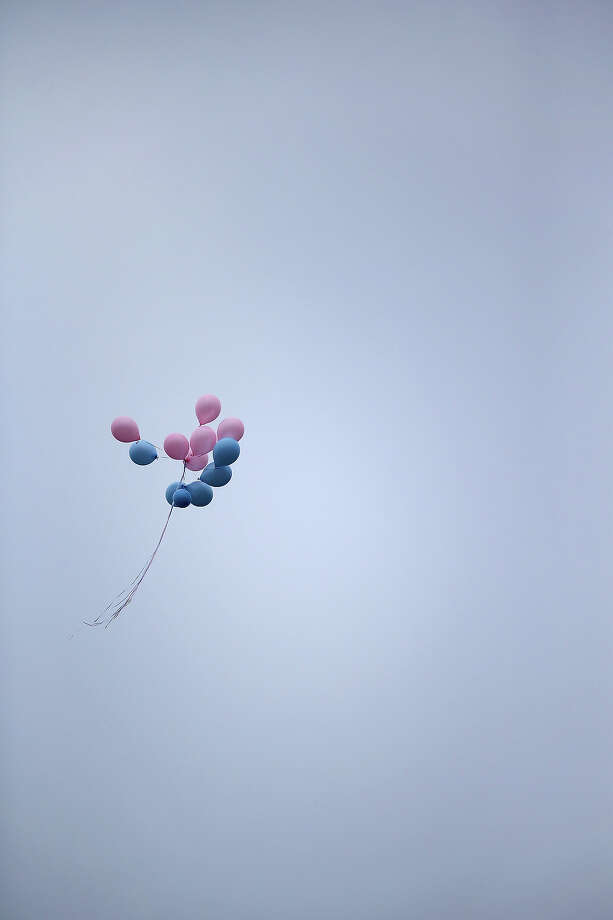 NEWTOWN, CT - DECEMBER 18:  A bunch of balloons flies over a funeral service for shooting victim Jessica Rekos, 6, on December 18, 2012 in Newtown, Connecticut. Funeral services were held in Newtown Tuesday for Jessica Rekos and James Mattioli, 6, four days after 20 children and six adults were killed at Sandy Hook Elementary School. Photo: John Moore, Getty Images / 2012 Getty Images