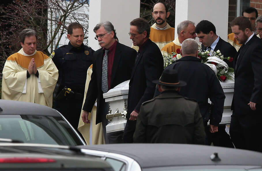 NEWTOWN, CT - DECEMBER 18:  The casket of James Mattioli, 6, is carried out after his funeral at the