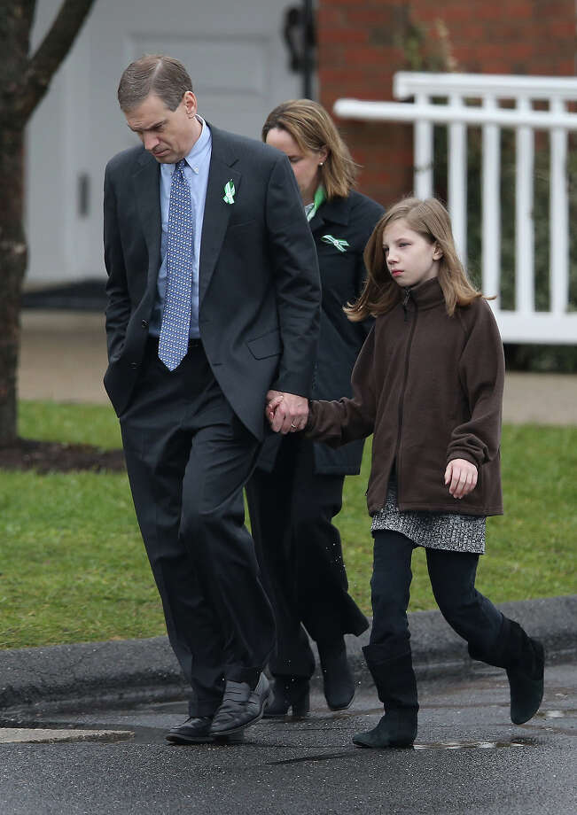 NEWTOWN, CT - DECEMBER 18:  People arrive for the funeral of James Mattioli, 6, at the St. Rose of Lima Catholic church on December 18, 2012 in Newtown, Connecticut. Funeral services were held at the church for both James Mattioli and Jessica Rekos, 6, Tuesday, four days after 20 children and six adults were killed at Sandy Hook Elementary School. Photo: John Moore, Getty Images / 2012 Getty Images